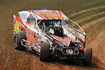 Feb 19, 2014; 6:42:59 PM;  Barberville, FL, USA;  Super DIRT car Series Big Block Modifieds presented by Summit Racing Equipment at Volusia Speedway Park.  Mandatory Credit: (thesportswire.net)