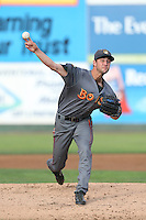Trevor Clifton #22 of the Boise Hawks pitches against the Everett AquaSox at Everett Memorial Stadium on July 22, 2014 in Everett, Washington. Everett defeated Boise, 6-0. (Larry Goren/Four Seam Images)