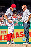 8 July 2017: Washington Nationals starting pitcher Stephen Strasburg indicates to the Director of Athletic Training, Paul Lessard, where he was hit by a ball during play against the Atlanta Braves at Nationals Park in Washington, DC. The Braves shut out the Nationals 13-0 to take the third game of their 4-game series. Mandatory Credit: Ed Wolfstein Photo *** RAW (NEF) Image File Available ***