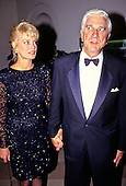 Actor Leslie Nielson, left, and Barbaree Earl, left, arrive for the State Dinner hosted by United States President George H.W. Bush and first lady Barbara Bush honoring President Václav Havel of Czechoslovakia at the White House in Washington, DC on October 22, 1991.<br /> Credit: Ron Sachs / CNP