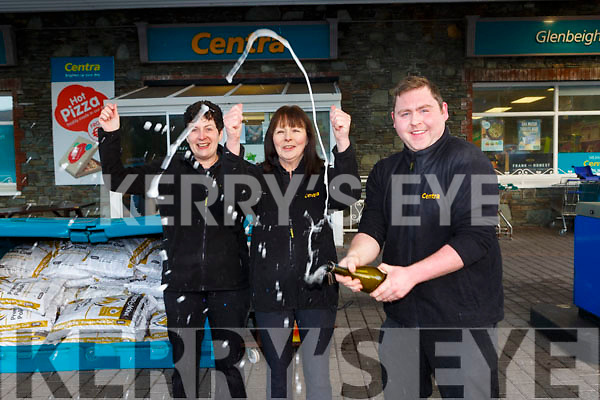 Dean Finn pops the champagne with Josephine Foley and Dympa Sheahan as the celebrate selling the winning Lotto ticket in Sheahans Centra in Glenbeigh