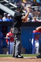 Umpire Ryan Wilhelms makes a call during a Williamsport Crosscutters game against the Batavia Muckdogs on July 16, 2015 at Dwyer Stadium in Batavia, New York.  Batavia defeated Williamsport 4-2.  (Mike Janes/Four Seam Images)