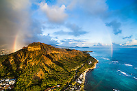 At sunset, an aerial perspective of a massive full rainbow around Diamond Head, Southeast O'ahu.