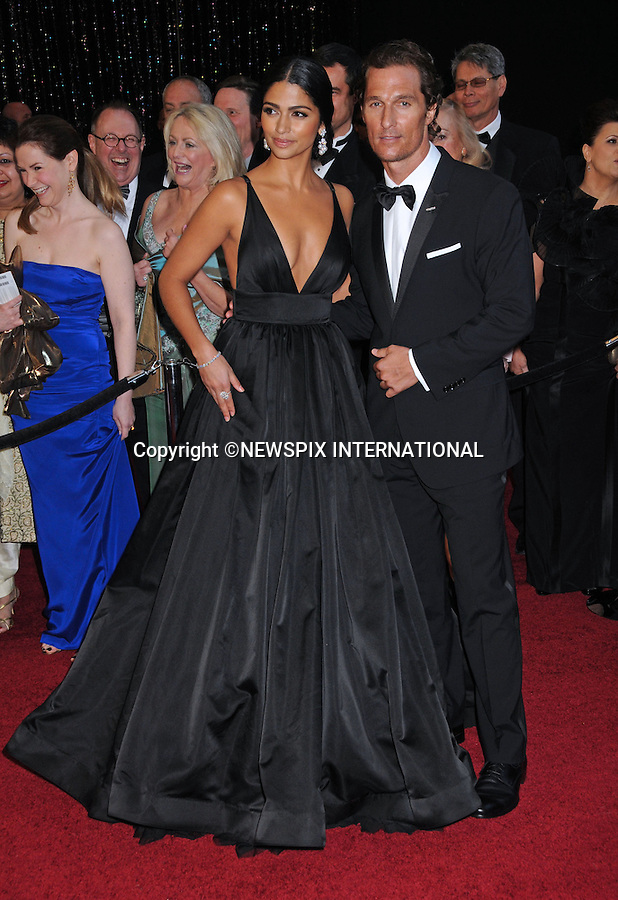 "MATHEW McCONAUGHEY AND CAMILA ALVES - Oscars 2011.83rd Academy Awards arrivals, Kodak Theatre, Hollywood, Los Angeles_27/02/2011.Mandatory Photo Credit: ©Phillips-Newspix International..**ALL FEES PAYABLE TO: ""NEWSPIX INTERNATIONAL""**..PHOTO CREDIT MANDATORY!!: NEWSPIX INTERNATIONAL(Failure to credit will incur a surcharge of 100% of reproduction fees)..IMMEDIATE CONFIRMATION OF USAGE REQUIRED:.Newspix International, 31 Chinnery Hill, Bishop's Stortford, ENGLAND CM23 3PS.Tel:+441279 324672  ; Fax: +441279656877.Mobile:  0777568 1153.e-mail: info@newspixinternational.co.uk"