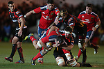 Dragons flanker Nic Cudd hauls down Munster number 8 James Coughlan.<br /> RaboDirect Pro12<br /> Newport Gwent Dragons v Munster<br /> Rodney Parade - Newport<br /> 29.11.13<br /> &copy;Steve Pope-SPORTINGWALES