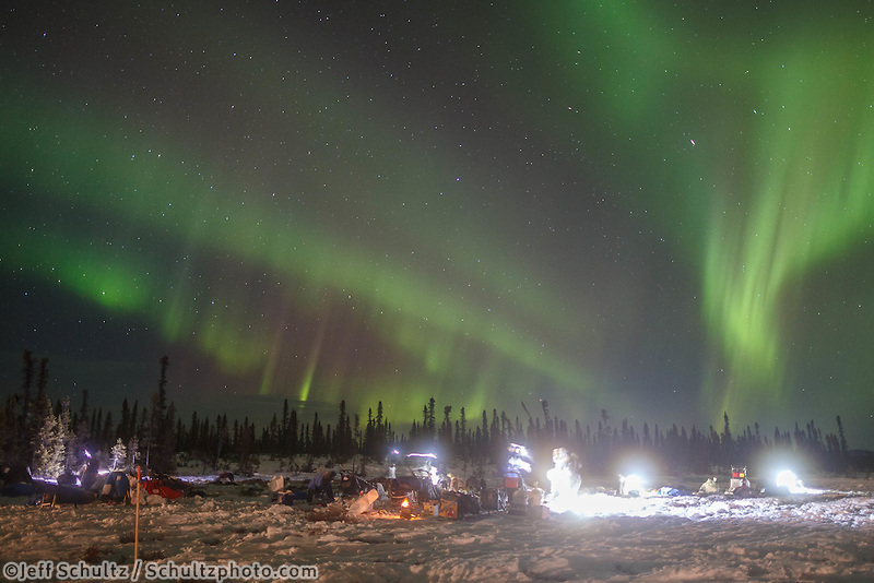 The Northern lights light up the sky at the Cripple checkpoint as mushers camp on Thursday March 10 during Iditarod 2016.  Alaska.    <br /> <br /> Photo by Jeff Schultz (C) 2016  ALL RIGHTS RESERVED