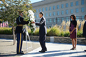 United States President Barack Obama commemorates the 11th anniversary of the 9-11 attacks with a wreath laying ceremony at the Pentagon, on September, 11, 2012 in Arlington, Virginia.  First lady Michelle Obama looks on from the right..Credit: Olivier Douliery / Pool via CNP