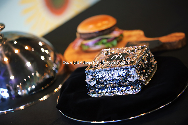 """Pictured: The new McDonalds burger box designed by Julien Macdonald at the Fabian Way restaurant in Swansea, Wales, UK. Wednesday 30 August 2017<br /> Re: McDonalds UK has revealed it has paired up with fashion industry icon, Julien Macdonald OBE to unveil his interpretation of a luxe burger box for McDonald's Signature Collection, its popular range of gourmet burgers.<br /> Julien Macdonald OBE was commissioned to bring his undeniably glamourous aesthetic, to combine fashion and food's finest. Julien's unique red carpet gowns and embellished styles have cemented him as a go-to brand for A-list international talent who are often praised for their stylish choices.<br /> Julien will unveil his creation for The Signature Collections - which is the embodiment of pure luxury and features crystal detailing, embellishment and bespoke digital print, along with McDonald's iconic Golden Arches - at a Signature Collection premiere event in its flagship Leicester Square restaurant.<br />  """"I drew inspiration from my fashion creations and iconic embellished red carpet dresses. This was translated into a gold baroque crystal encrusted box, which is the perfect packaging for the luxury McDonald's Signature Collection burger,"""" commented Julien.<br />  The Signature Collection has been on trial in selected restaurants, and following great customer response, will now be available in over 900 McDonald's restaurants across the UK by year-end."""
