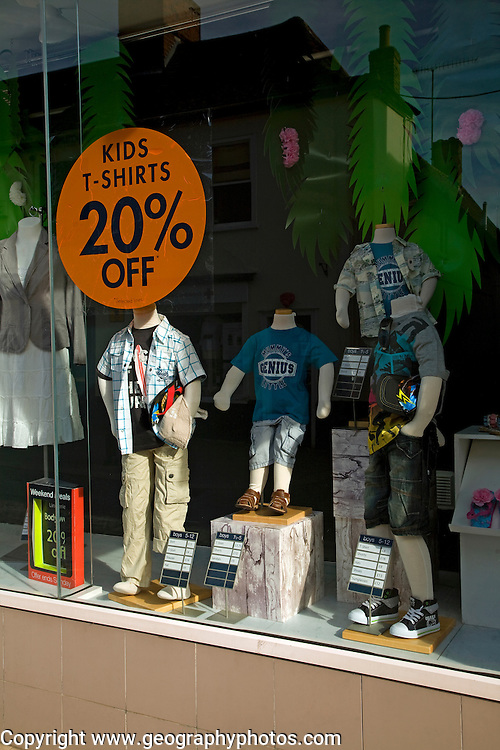 Shop window display children's clothing on sale, Mackays store, Woodbridge, Suffolk, England