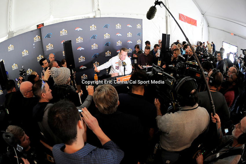 Tuesday, February 2, 2016: Denver Broncos quarterback Peyton Manning (18) is surrounded by media during a press conference for the National Football League Super Bowl 50 between the Denver Broncos and the Carolina Panthers. Eric Canha/CSM