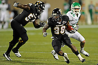 1 September 2011:  FIU running back Darriet Perry (28) carries the ball in the second half as the FIU Golden Panthers defeated the University of North Texas, 41-16, at FIU Stadium in Miami, Florida.
