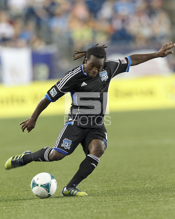 San Jose Earthquakes midfielder Walter Martinez (10) crosses the ball.  In a Major League Soccer (MLS) match, the New England Revolution (white) defeated San Jose Earthquakes (black), 2-0, at Gillette Stadium on July 6, 2013.