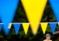 A young swimmer (model released) competes in local swimming competition in Charlotte NC. The pre-teen athlete is participating in a summer swim program hosted by his local YMCA.