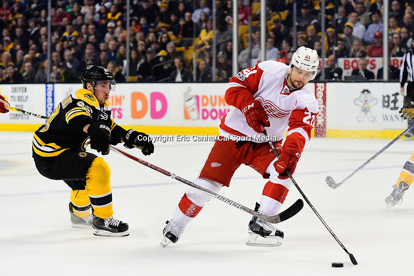 Tuesday, January 24, 2017: Boston Bruins left wing Brad Marchand (63) works to check a pass by Detroit Red Wings left wing Tomas Tatar (21) during the National Hockey League game between the Detroit Red Wings and the Boston Bruins held at TD Garden, in Boston, Mass. Boston defeats Detroit 4-3 in overtime. Eric Canha/CSM