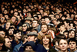 CROWD OF FACES OF MALE & FEMALE LIVERPOOL FOOTBALL FANS WATCHING MATCH FROM STANDS,