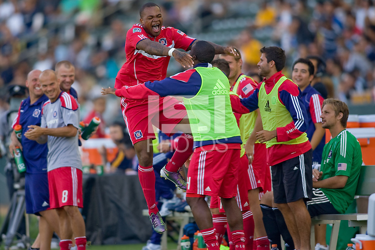 Chicago Fire forward Collins John celebrates his goal by jumping into the arms of teammate Kwame Watson-Siriboe. The Chicago Fire beat the LA Galaxy 3-2 at Home Depot Center stadium in Carson, California on Sunday August 1, 2010.