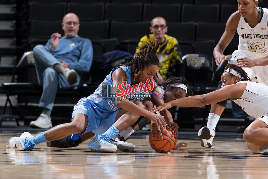 N'Dea Bryant (22) of the North Carolina Tar Heels battles for a loose ball with Amber Campbell (2) and Ataijah Taylor (3) of the Wake Forest Demon Deacons during first half action at the LJVM Coliseum on January 21, 2016 in Winston-Salem, North Carolina.  The Demon Deacons defeated the Tar Heels 75-63.  (Brian Westerholt/Sports On Film)