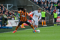 SWANSEA, WALES - APRIL 04: Angel Rangel of Swansea City  in action during the Premier League match between Swansea City and Hull City at Liberty Stadium on April 04, 2015 in Swansea, Wales.  (photo by Athena Pictures)