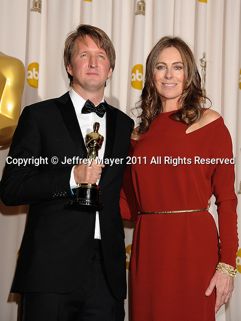 HOLLYWOOD, CA - FEBRUARY 27: Tom Hooper and Kathryn Bigelow pose in the press room during the 83rd Annual Academy Awards held at the Kodak Theatre on February 27, 2011 in Hollywood, California.