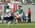 24 June 2007:  USA's Clint Dempsey (l) and Mexico's Jose Andres Guardado (18). The United States Men's National Team defeated the national team of Mexico 2-1 in the CONCACAF Gold Cup Final at Soldier Field in Chicago, Illinois.