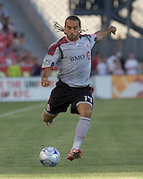 Toronto FC midfielder Dwayne De Rosario (14) crosses the ball. Salt Lake Real defeated Toronto FC, 3-0, at Rio Tinto Stadium on June 27, 2009.