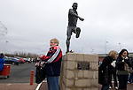 Middlesbrough 1 Preston North End 1, 22/01/2011. Riverside Stadium, Championship. Supporters gather beneath a statue of former player Wilf Mannion outside Middlesbrough FC's Riverside Stadium on the day the club played host to Preston North End in an Npower Championship fixture. The match ended in a one-all draw watched by a crowd of 16,157. Middlesbrough relocated from their former home at Ayresome Park in 1995. Photo by Colin McPherson.