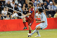 Kyle Beckerman, (red) Real Salt Lake watched by Roger Espinoza Sporting KC... Sporting Kansas City defeated Real Salt Lake 2-0 at LIVESTRONG Sporting Park, Kansas City, Kansas.