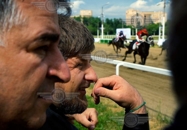 Chechen President Ramzan Kadyrov watches his horse 'Royal Quiet' in a race at Moscow's Hippodrome.