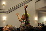 A worshiper stands up to pray during a prayer send-off for Roland Burris, Illinois Governor Rod Blagojevich's pick to fill Barack Obama's U.S. Senate seat, prior to Burris' departure to Washington at the New Covenant Baptist Church on the South Side of Chicago, Illinois on January 4, 2008.