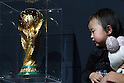 Apr 25, 2010 - Tokyo, Japan - A baby looks at the World Cup trophy during a one-day special event at Laforet Harajuku in Tokyo, on April 25, 2010. The trophy arrived in Japan on April 23, as part of its 225-day global tour in the lead-up to the finals of the FIFA World Cup football tournament in South Africa.