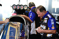 Sept. 28, 2012; Madison, IL, USA: Mark Oswald , crew chief of NHRA top fuel dragster driver Antron Brown during qualifying for the Midwest Nationals at Gateway Motorsports Park. Mandatory Credit: Mark J. Rebilas-