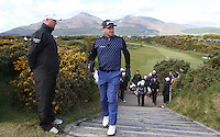 Thursday 28 May 2015; Graeme McDowell walks onto the 14th tee box<br /> <br /> Dubai Duty Free Irish Open Golf Championship 2015, Round 1 County Down Golf Club, Co. Down. Picture credit: John Dickson / SPORTSFILE
