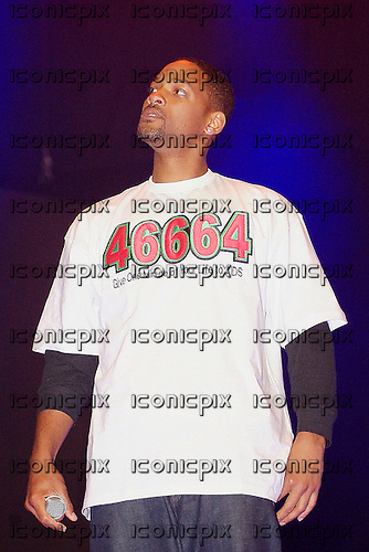 WILL SMITH - performing live wearing a 46664 t-shirt at the 2005 Urban Music Fest held at Earls Court Arena, London UK - 16 Apr 2005.  Photo credit: George Chin/IconicPix