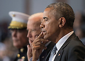 United States President Barack Obama (R), Vice President Joe Biden (C) and Chairman of the Joint Chiefs of Staff Gen. Joseph Dunford Jr. attends the Armed Forces Full Honor Review Farewell Ceremony for President Obama at Joint Base Myers-Henderson Hall, in Virginia on January 4, 2017. The five braces of the military honored the president and vice-president for their service as they conclude their final term in office. <br /> Credit: Kevin Dietsch / Pool via CNP