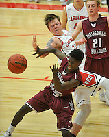 NWA Democrat-Gazette/MICHAEL WOODS &bull; @NWAMICHAELW<br /> Cade Fenton (22), Farmington forward and Springdale defender Devon Young (3) fight for the loose ball during their game Tuesday, November 17, 2015 in Farmington.