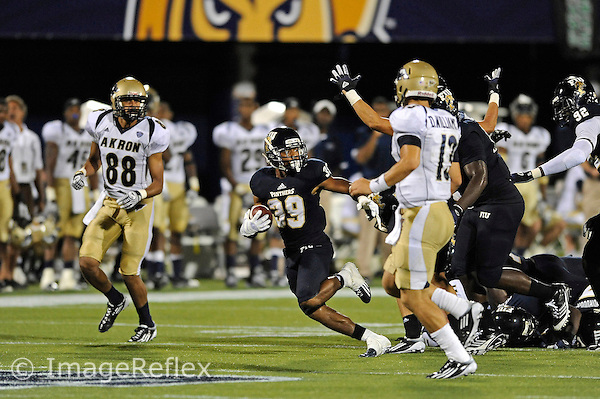 8 September 2012:  FIU cornerback Sam Miller (39) runs after stripping the ball in the third quarter as the FIU Golden Panthers defeated the Akron Zips, 41-38 (overtime), at FIU Stadium in Miami, Florida.