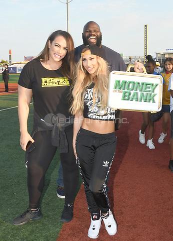 Brooklyn, NY - AUGUST 17: WWE Superstars Nia Jax, Mark Henry and Carmella visits MCU Park in Brooklyn, New York on August 17, 2017 during Summer Slam Week. Photo Credit: George Napolitano/MediaPunch