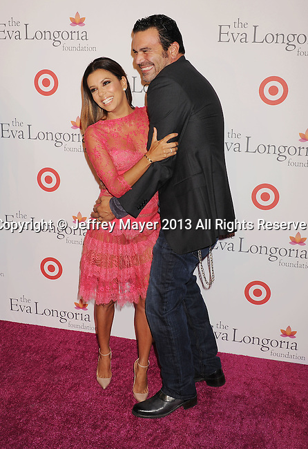 HOLLYWOOD, CA- SEPTEMBER 28: Actors Eva Longoria and Ricardo Antonio Chavira arrive at the Eva Longoria Foundation Dinner at Beso restaurant on September 28, 2013 in Hollywood, California.