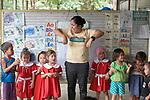 Christian Love Daroy-Gagno, the program director of the Kapatiran-Kaunlaran Foundation (KKFI), sings with children in a KKFI-sponsored preschool in Pulilan, a village in Bulacan, Philippines.<br /> <br /> KKFI is supported by United Methodist Women.