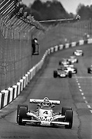 HAMPTON, GA - APRIL 22: Johnny Rutherford leads the field in his  McLaren M24B/Cosworth TC enroute to winning the Gould Twin Dixie 125 event on April 22, 1979, at Atlanta International Raceway near Hampton, Georgia.