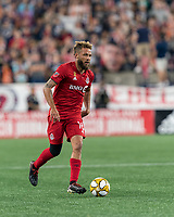 FOXBOROUGH, MA - AUGUST 31: Nick DeLeon #18 of Toronto FC dribbles during a game between Toronto FC and New England Revolution at Gillette Stadium on August 31, 2019 in Foxborough, Massachusetts.
