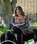 United States first lady Michelle Obama with her dogs, Bo and Sunny, attends the annual White House Easter Egg Roll on the South Lawn of the White House April 21, 2014 in Washington, DC. President Barack Obama and first lady Michelle Obama hosted thousands of people during the annual celebration of Easter. <br /> Credit: Olivier Douliery / Pool via CNP