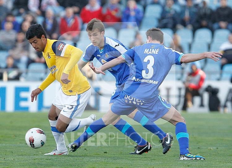 Getafe's Rafa Lopez (c) and Mane Jimenez (r) and Real Sociedad's Carlos Vela (l) during La Liga match.March 17,2012. (ALTERPHOTOS/Acero)