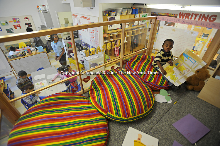 Keyoveun Williams 3, plays in the loft while others work at a table in the classroom below at the Educare Early Childhood Center in Chicago on November 21, 2008.  The pre-K daycare center is a model for head start, funded privately by the Gates and other foundations, that cares for and educates infants, toddlers, and 3- and 4-year old pre-school children.
