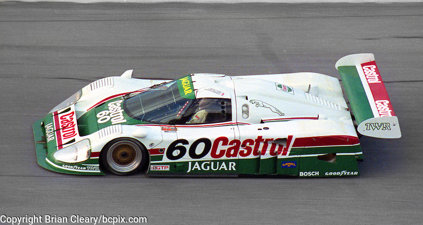 The #60 Jaguar XJR-12 of Price Cobb, John Nielson, and Martin Brundle races through the banking en route to a 2nd place finish in the SunBank 24 at Daytona at Daytona Internatonal Speedway, Daytona Beach, FL, February 3-4, 1990.  (Photo by Brian Cleary/www.bcpix.com)