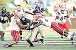 2 September 2006: Wake Forest's Kevin Marion (center) tries to fight through the tackle of Syracuse's Kelvin Smith (8) and Dowayne Davis (26). Wake Forest defeated Syracuse 20-10 at Groves Stadium in Winston-Salem, North Carolina in an NCAA college football game.