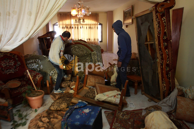 Palestinians inspect their house following raided by Israeli security forces in the occupied West Bank Askar neighborhood, near Nablus 18 December 2013. In Nablus, Israeli military jeeps raided the refugee camps of Balata, Askar and el-Ein, as well as the neighborhoods of al-Mureij and Rafidia, and detained seven Palestinians. Photo by Nedal Eshtayah