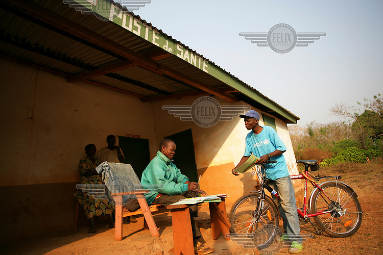 Local UNICEF worker visiting rural health post.