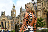 LONDON, ENGLAND - SEPTEMBER 11: Painted as a tiger, supermodel Joanna Krupa joins PETA to call for ban on animal circuses and to urge government to introduce long-overdue legislation, outside Westminster, London. <br /> CAP/JOR<br /> &copy;JOR/Capital Pictures