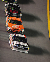 Feb 9, 2008; Daytona, FL, USA; Nascar Sprint Cup Series driver Dale Earnhardt Jr (88) leads Tony Stewart (20) during the Bud Shootout at Daytona International Speedway. Mandatory Credit: Mark J. Rebilas-US PRESSWIRE